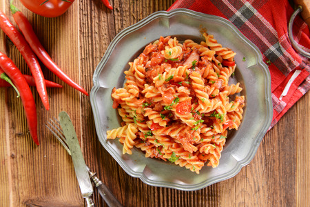 pasta sauce: Pasta with hot tomato sauce and chili pepper Stock Photo