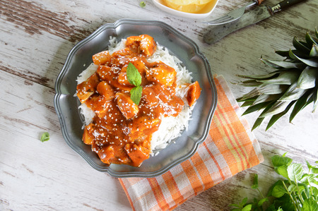 enticing: Chicken in caribbean style with pineapple and rice