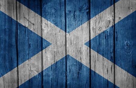 scotish: Scotland flag painted on old wooden background Stock Photo