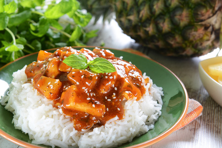 jamaican food: Chicken in caribbean style with pineapple and rice