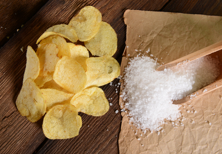 salt shaker: Potato chips with sea salt Stock Photo