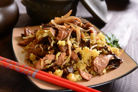 china cuisine: Fried rice with meat, mushrooms and soi