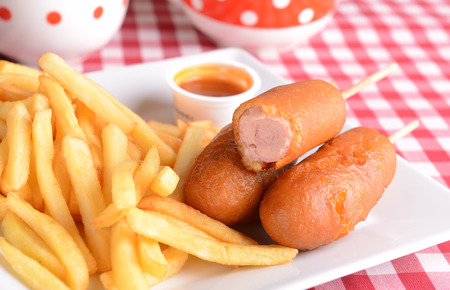 dog background: Corn dogs with fries