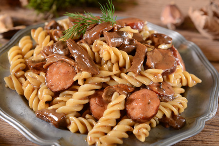 fussili: Fussili pasta with mushrooms and sausage