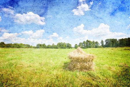 haystack: Summer landscape with haystack and blue sky- vintage style