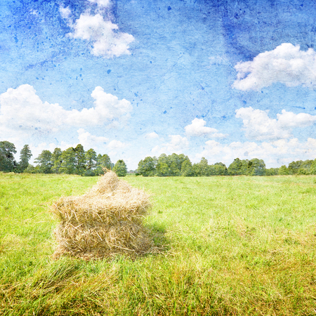 hay bales: Summer landscape with haystack and blue sky- vintage style