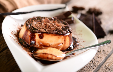 panna cotta: Panna cotta with chocolate suace and chocolate flakes Stock Photo