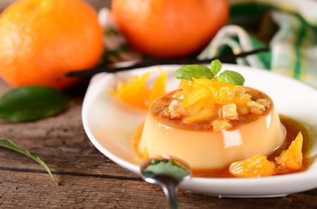 Italian dessert panna cotta with orange sauce
