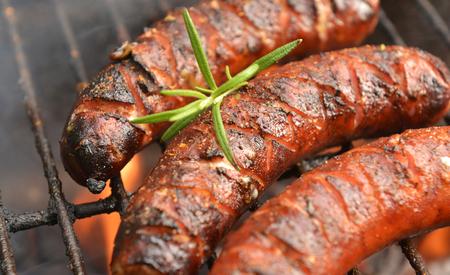 chorizos asados: Grilled sausages Foto de archivo