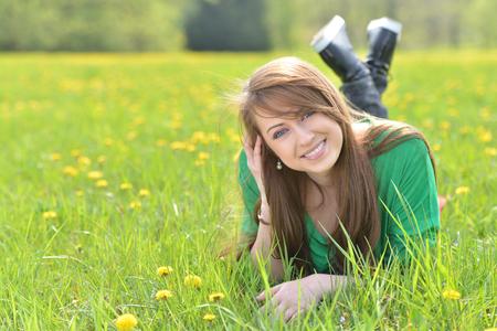 vouge: Beautiful girl on green grass