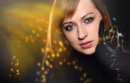 Beautiful caucasian brunette over black background photo