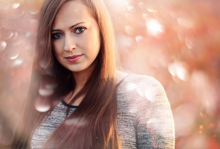 Autumn portrait of beautiful caucasian girl photo
