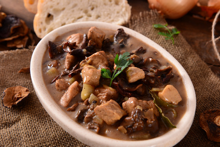 Stew with meat, mushrooms and vegetables