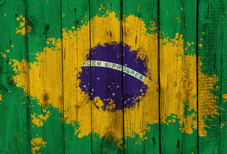 Brazil flag painted on old wooden wall