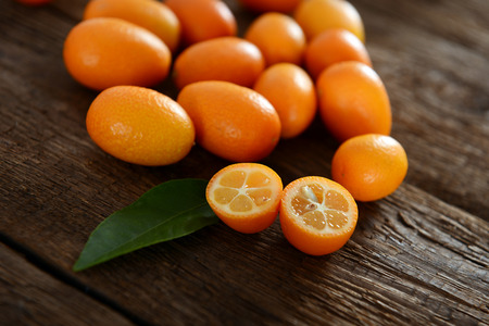 Kumquat fruits on old wooden table
