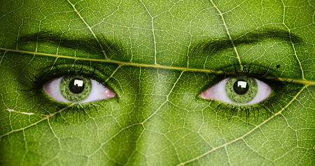 Leaf texture on human face. Ecology concept. Stock Photo