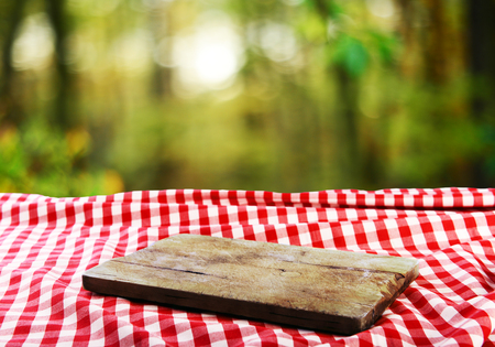 Empty table with empty cutting board for product display montages
