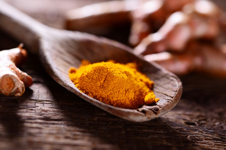 Turmeric spice on old wooden table
