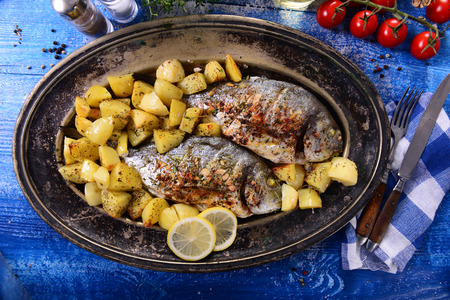 Fried bream fish with potatoes