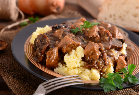 Stew with meat, mushrooms and vegetables served with groat Stok Fotoğraf