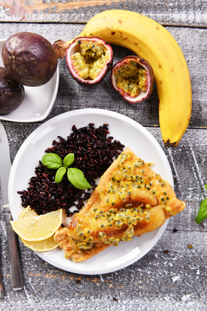 Traditional madeira dish - scabbardfish with bananas and passion fruit Standard-Bild - 114121085