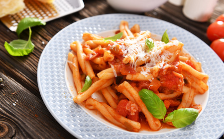 Italian style pasta with tomato sauce Фото со стока