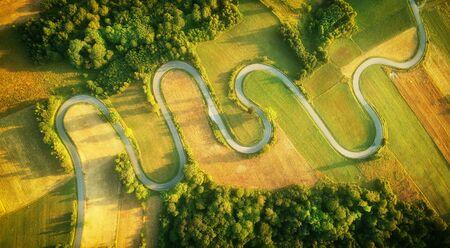 Drone aerial view - windy road in summer Standard-Bild