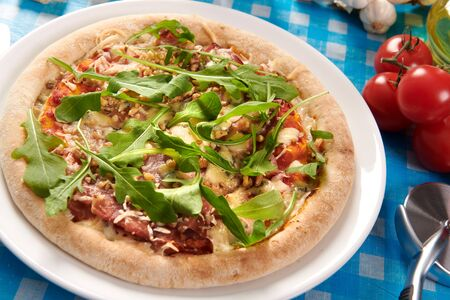 Pizza with prosciutto ham, walnuts, gorgonzola cheese and walnuts Stock Photo