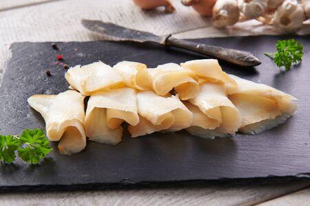 Delicious smoked halibut slices close up Reklamní fotografie