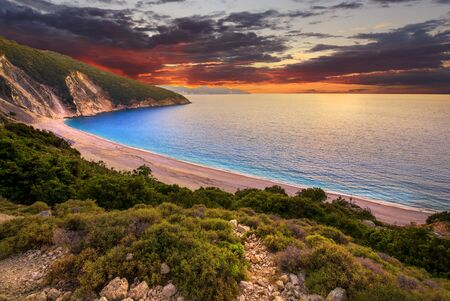 Beautiful summer sunset on Mirtos beach in Greece