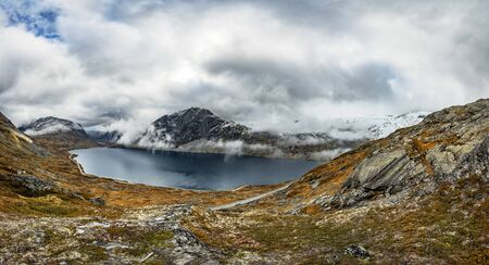 Autumn landscape of cloudy Norway - panorama Standard-Bild