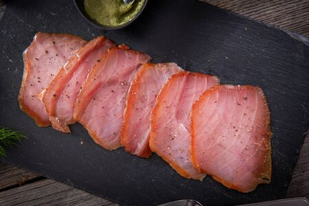 Tasty cold smoked tuna slices