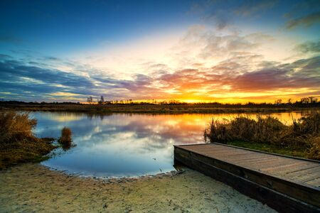 Beautiful sunrise over river banks Standard-Bild