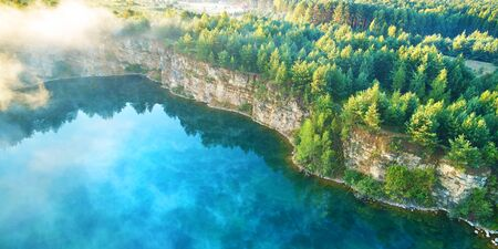 Aerial landscape from the drone - blue water and cliff