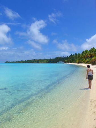 Girl Walking on Tropical Beach