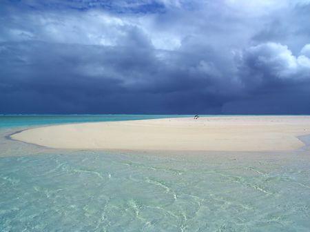 Storm approaching over sandbar Stock Photo