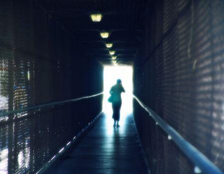 Walking into Light Stock Photo