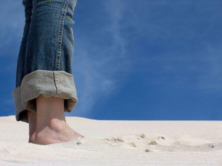Closeup of 2 feet on sand dune