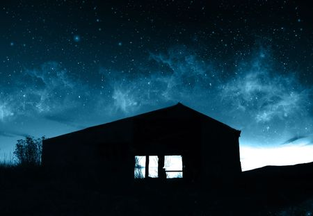 unearthly: Supernatural Concept - Silhouette of farmhouse in front of abstract blue sky