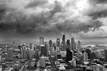 looming: Dark Storm clouds loom over the city of Seattle