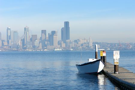 contrasting: Row Boat with the city of Seattle in the background