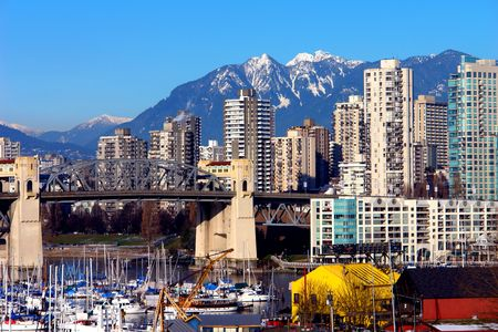 snow capped mountain: City of Vancouver with mountains in the background