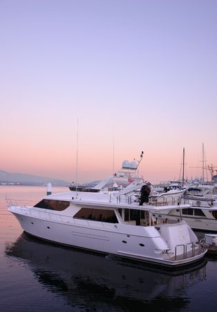 Boat in harbour with pink sunset photo