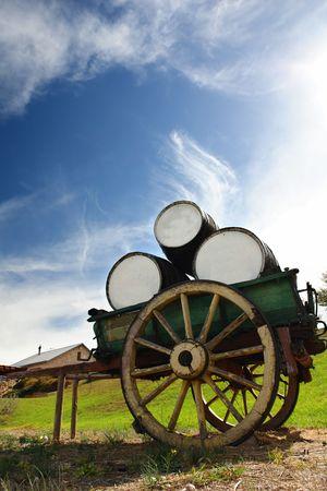old wood farm wagon: Old Cart Holding Wine Barrels on a farm