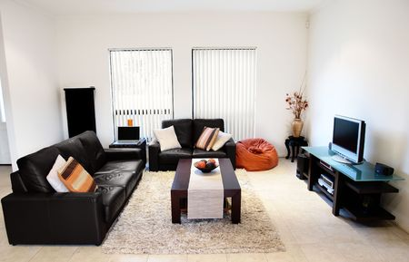 modern apartment: Orange and Brown Interior Stock Photo