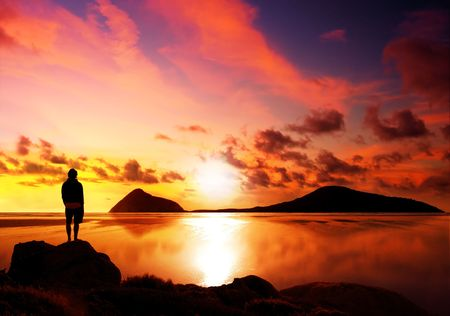 wilsons promontory: Silhouette of man reflecting while looking at a gorgeous sunset Stock Photo
