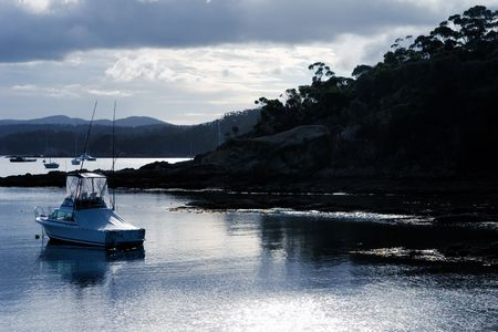 Fishing Boat moored in peaceful bay photo
