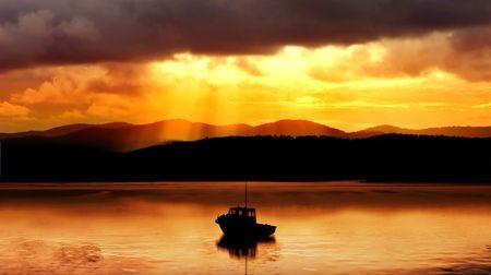 Fishing boat and amazing sunset Stock Photo - 2738148