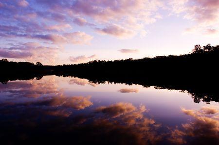 Sun sets over a peaceful lake Stock Photo - 3421523