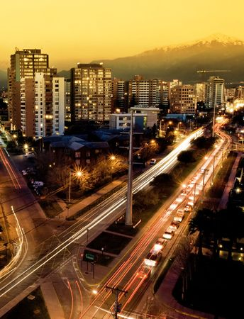 A busy road in Santiago with the Andes in the background